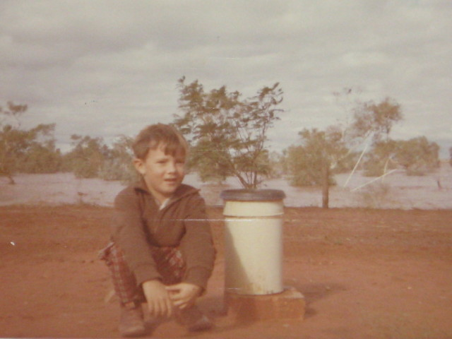 Neville beside Rain Guage during floods - Ooratippra Station late 60's